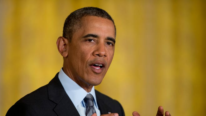 President Obama speaks about the 'promise zone' plan Thursday, Jan. 9, in the East Room of the White House.