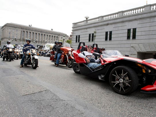 State Rep. Harry Readshaw being chauffeured in a Slingshot