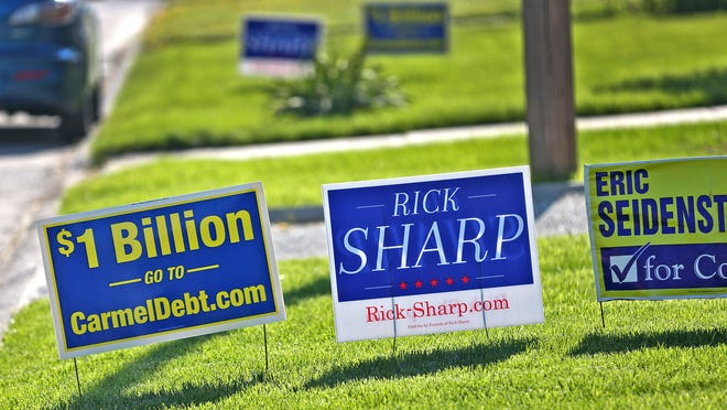 Political signs can be seen in people's lawns, Friday, May 1, 2015.