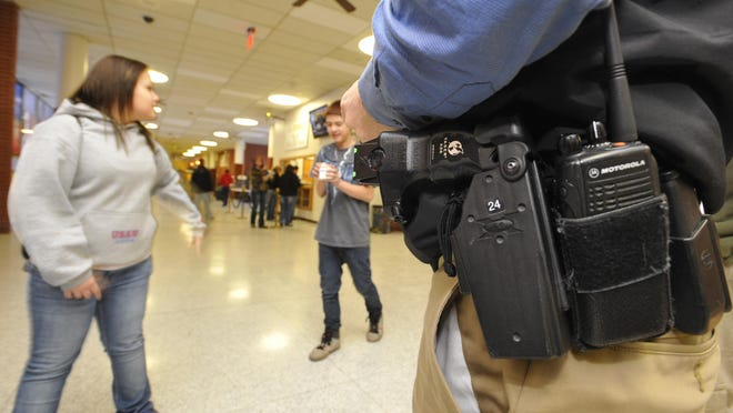 A School Resource Officer walks a CMR hallway during a passing period on Feb. 2, 2011.