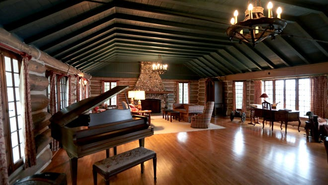 This summer lodge has characteristics of a rustic cabin — with a more refined purpose in mind. These wood floors and exposed log beams are found in the ballroom, which is now used as a more general entertaining space.