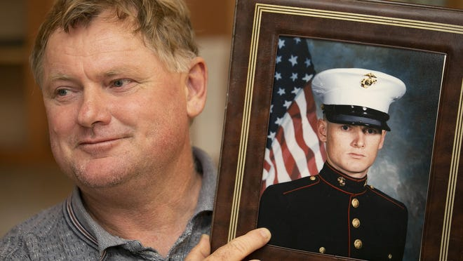 Paul Canton, who was born in New Zealand, was told when he joined the U.S. Marine Corps in 1991 that would automatically be a U.S. citizen if he served four years. [Doug Engle/Ocala Star-Banner file]2020