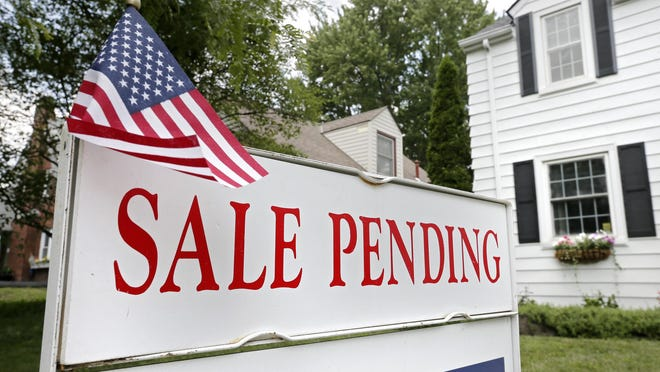 """A """"Sale Pending"""" sign hangs outside a home on Grandon Avenue in Bexley on Tuesday. In the Columbus area, homes go in contract after a median of five days on the market."""
