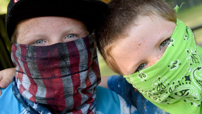 Brothers Dylan, 9, and Zach, 6, Lay wore masks to the day camp at the Monroe Family YMCA Monday.