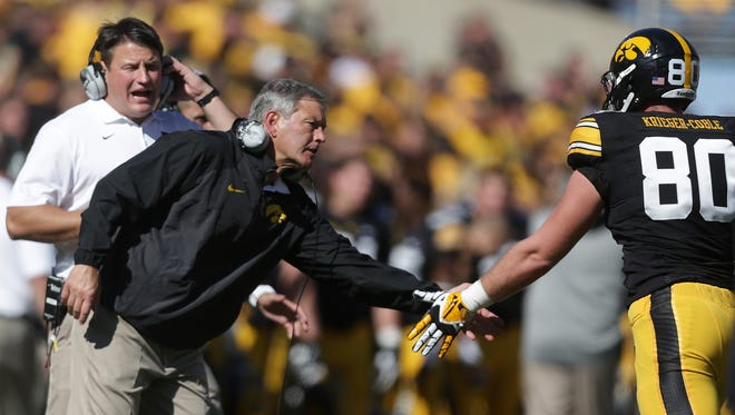 Iowa coach Kirk Ferentz celebrates with tight end Henry Krieger-Coble against Indiana on Saturday, Oct. 11, 2014, at Kinnick Stadium in Iowa City, Iowa.