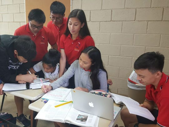 Students study for Advanced Placement test. From left: James Zong, Rylean Pama Martin Ma, Tatiana Reyes, Mia Gumban and Stanley Au.