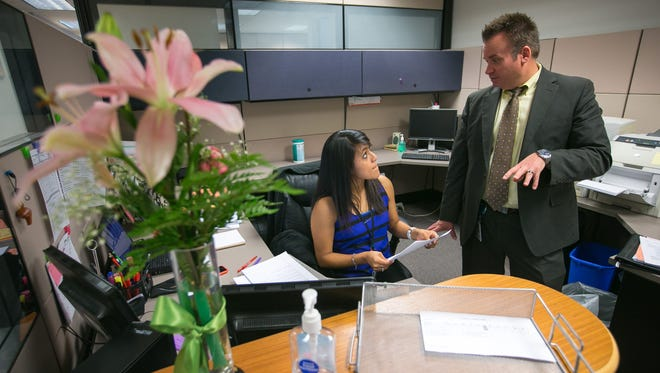 Ellie Perez, District 8 council aide, discusses an upcoming event with acting Planning and Development Director Alan Stephenson. Budgets for staffs vary between council districts.