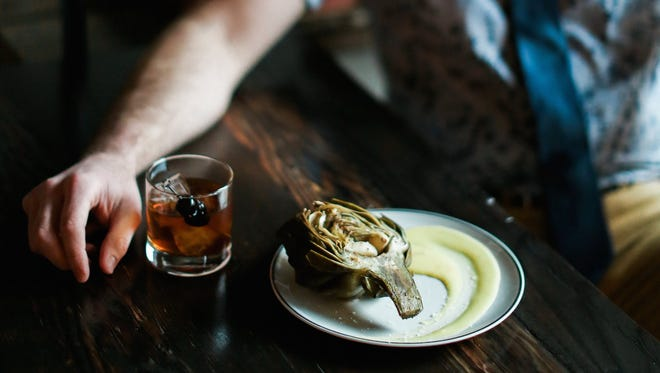 Garlic roasted artichoke and saffron hollandaise is on the new dinner menu at Archive Coffee and Bar.