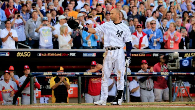 The Yankees' Derek Jeter acknowledges the crowd before his first at bat during the 85th MLB All-Star Game at Target Field on Tuesday, in Minneapolis.
