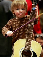 The Country Music Hall of Fame Instrument  Petting Zoo programs at area libraries offer a hands on musical experience for little ones.