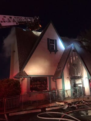 IFD officials are looking into the cause of a fire that did $800k in damage to an adult store in Castleton.