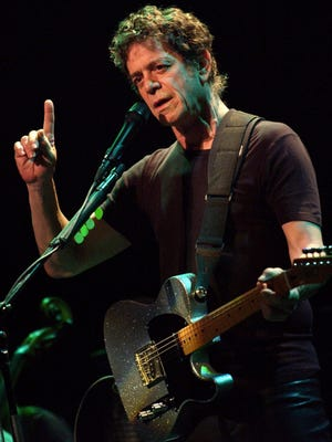 Lou Reed performs at the Casino de Paris in 2003.