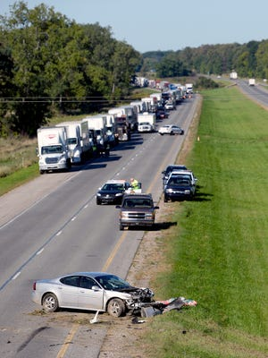 First responders on the scene of a fatal three-car crash on eastbound Interstate 96 Monday, Sept. 19, 2016, near Williamston.
