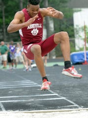 Asheville High's Mekhi McGuyer has overcome a difficult personal life to win two state 3-A championships in the triple jump.