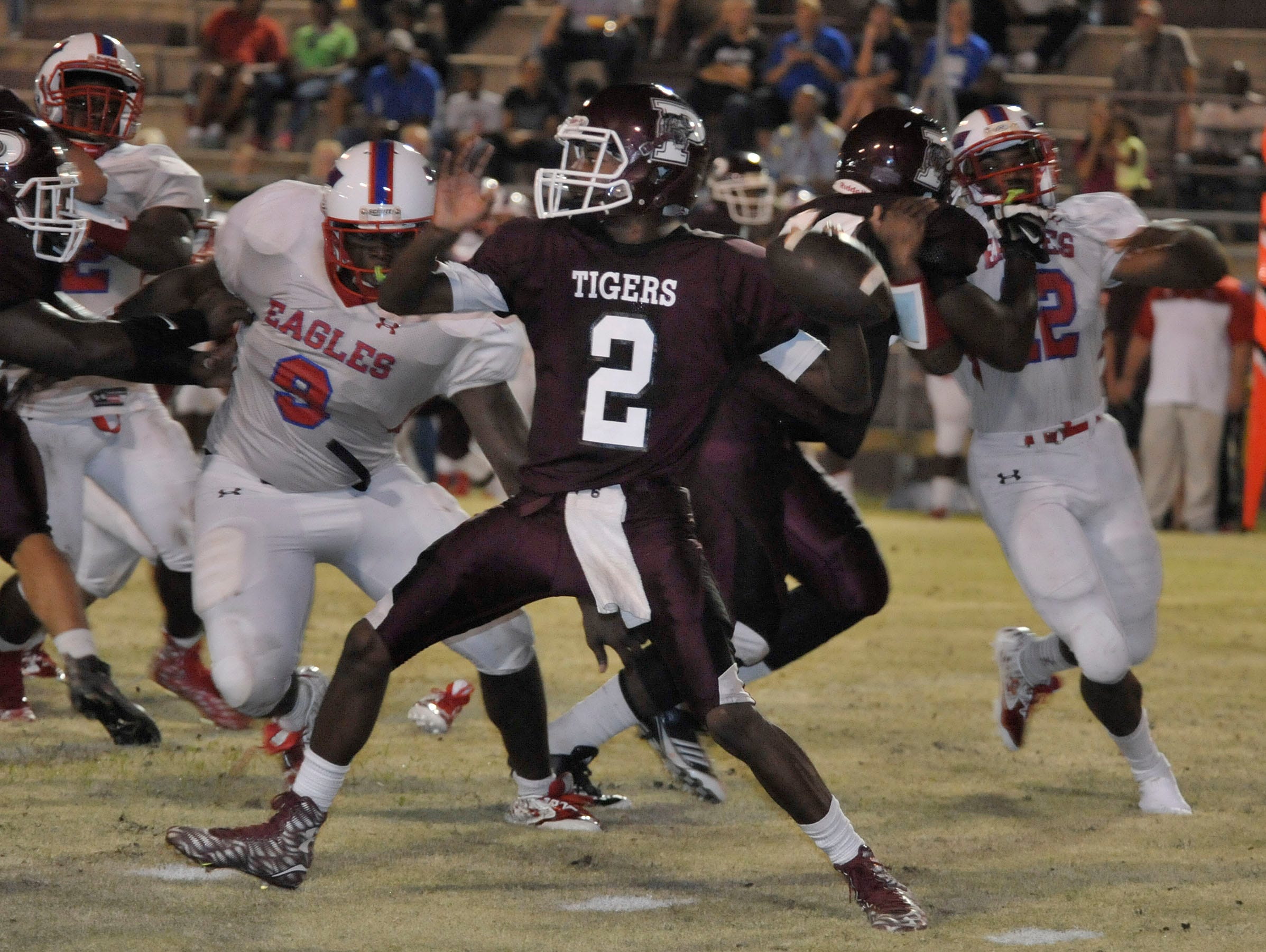 Pensacola High Tigers QB, Sederick Smith, throws under pressure from the Pine Forest Eagle defense during their game Friday night at PHS.