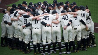 Vanderbilt baseball players gather around former teammate Donny Everett's number on the field before their home opener against Evansville on Wednesday at Hawkins Field. Everett drowned just before the NCAA Regional last season.