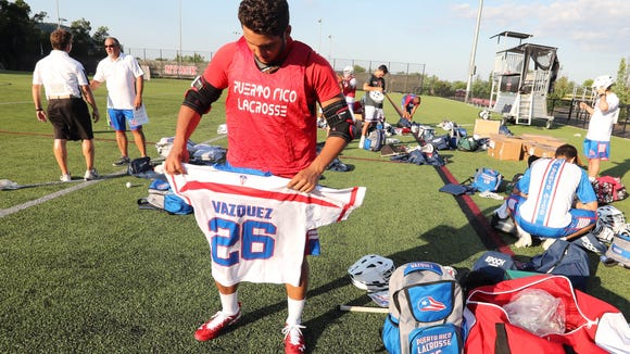Nick Vasquez a 2016 graduate of Lakeland High School, check out his official jerseys before practicing with the Puerto Rican national lacrosse team at Nyack High School June 29, 2018. The team will be traveling to Israel next month to play in the FIL World Championships. Several player on the team are from Westchester and Rockland counties.