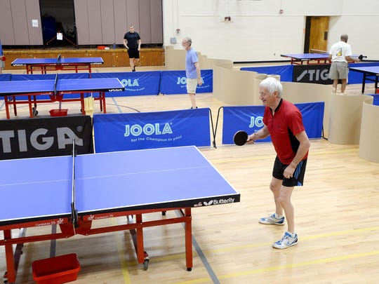 """Ken Macfarlane, vice president of the Asheville Table Tennis Club, readies himself for the ball as he takes on an opponent during an open play night at the Montford Recreation Center on Monday. """"What has happened is it's become a great social venue for a lot of guys that aren't necessarily competition minded but enjoy the camaraderie,"""" Mcfarlane said about the club."""