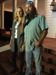 """""""Duck Dynasty"""" stars Korie and Willie Robertson speak to fans at the couple's western Ouachita  home Thursday before debuting the family's new fashion line."""