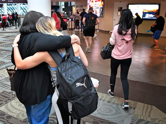Pam Thurman hugs her daughter Julie after her arrivial at BNA from Las Vegas where she witnessed the shooting.Monday Oct. 2, 2017, in Nashville, TN