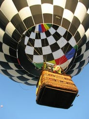 "Ron Nollen of the village of Merton is a hot air balloon pilot, his wife Deb Nollen is a crew chief. Their balloon is ""Last Lap"" is a loving tribute to legendary NASCAR drivers."