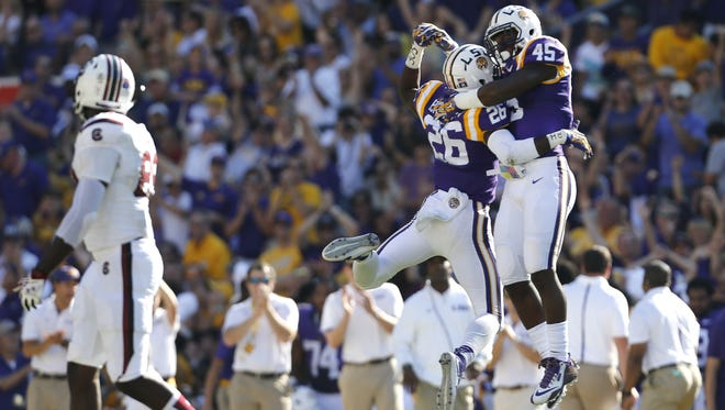 LSU safety John Battle (26) celebrates his interception with linebacker Deion Jones (45) during the first half of an NCAA college football game against South Carolina in Baton Rouge, La., Saturday, Oct. 10, 2015. (AP Photo/Jonathan Bachman)