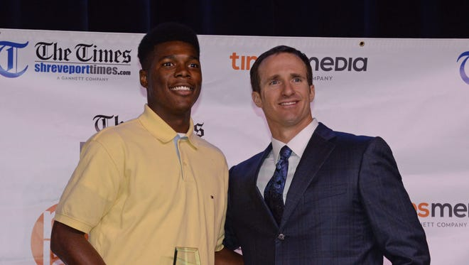 Drew Brees poses with the 2016 Best of Preps Male Athlete of the Year Keldrick Carpenter of Plain Dealing.