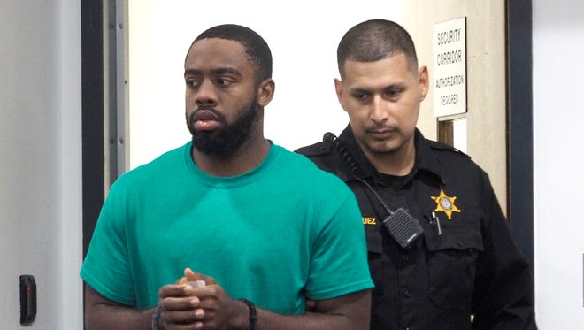 Former Rutgers college football player Izaia Bullock is escorted into Middlesex County Superior Court for a detention hearing, Friday, Nov. 2, 2018. in New Brunswick, N.J. Bullock is was charged with two counts of attempted murder and conspiracy. (Patti Sapone/NJ Advance Media via AP, Pool)