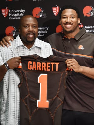 Cleveland Browns first-round pick defensive lineman Myles Garrett and his father Lawrence.