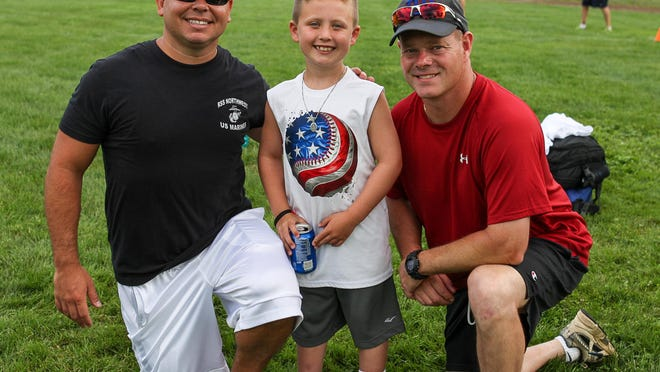 Roxbury PBA 311 raised funds for Joey Clayton, 8, at Roxbury's 10th Annual Wiffleball Tournament at Horseshoe Lake Field in Roxbury on August 1, 2015. From left, Joseph Clayton, Joey Clayton, 8, of Rockaway, and Roxbury Police Officer Brian Feeney.