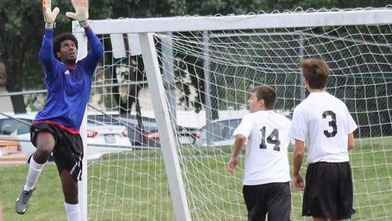 Jordan Williams elevates for a save.