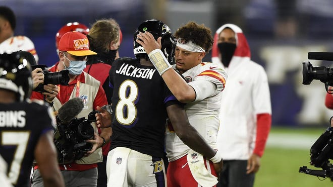 Baltimore Ravens quarterback Lamar Jackson (8) and Kansas City Chiefs quarterback Patrick Mahomes (15) embrace after an NFL football game, Monday, Sept. 28, 2020, in Baltimore. The Chiefs won 34-20.
