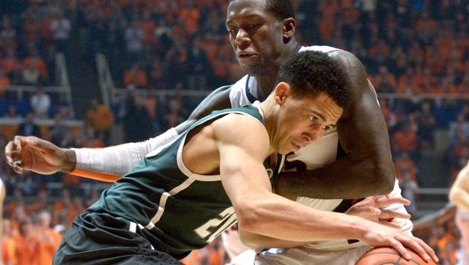Michigan State's Travis Trice drives into Illinois guard Kendrick Nunn during during MSU's 60-53 win Sunday at Illinois.