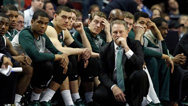 Michigan State head coach Tom Izzo watches the final minutes of overtime in front of his bench against Wisconsin in the Big Ten tournament title game in Chicago, Sunday, March 15, 2015. Wisconsin defeated Michigan State 80-69 in overtime.