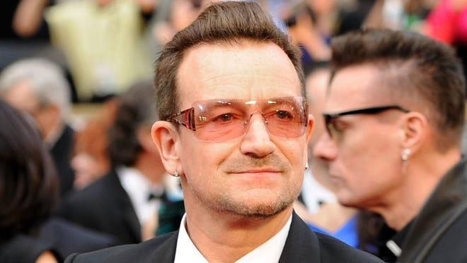 Bono arrives at the Oscars at the Dolby Theatre in Los Angeles on March 2, 2014. A New York City doctor says U2 singer Bono suffered multiple fractures and had to have two surgeries after his weekend bicycle accident. Orthopedic trauma surgeon Dr. Dean Lorich says Bono underwent a five-hour surgery on his elbow in which three plates and 18 screws were inserted on Sunday night. Bono had another surgery to repair a fracture to his left pinkie on Monday. Lorich says Bono will need therapy but a full recovery is expected.