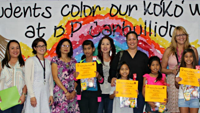 In support of the Positive Behavior Interventions and Supports program, Sylvan donated over 1,000 books to Guam's public elementary schools to promote literacy during January and February 2017. In recognition of their academic and behavioral achievements, Sylvans Center Director, Crystal Nelson, donated 25 books to B.P. Carbullido Elementary Students of the Month in K - 5th January 10. Pictured back row left: Litasha Babas (CES PTO Vice President), Dr. Lisa Cooper-Nurse (Principal) Anilita Basto (Assistant Principal), Mrs. Sarah Lake (4th grade teacher), Bella Santos-Cruz (4th grade teacher), Debra Whitt (4th grade teacher), Crystal Nelson (Sylvan Learning Center Director). Front row from left: Jackerlyn Mailo, Charlie Jade Arnaiz, Deena Petros, and Regan Suzuki (4th grade students)
