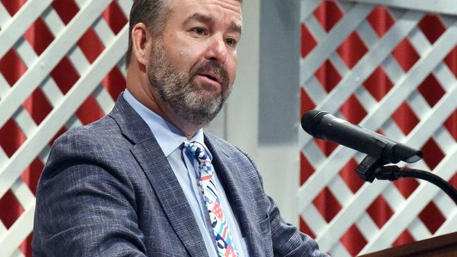 Steve Saint-Amand, principal of South Lenoir High School for the past 10 years, speaks at June's commencement exercise. Saint-Amand's retirement on Friday ends a 28-year career in education, all but two of those years spent at South Lenoir.