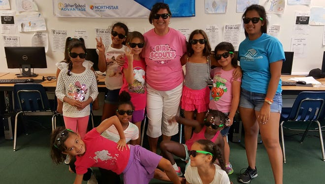Maria Aviles (center) of the Girl Scouts partnered with the Boys & Girls Club of Vineland to present healthy lifestyle sessions for female members as part of the club's summer enrichment program. The girls were given sunglasses to represent the fact that sometimes young people cannot always see clearly when making decisions in life.