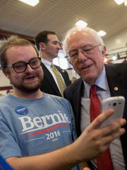 Democratic presidential candidate, Sen. Bernie Sanders, I-Vt. pauses for a photo with a supporter at a rally on Friday in Elko, Nev.