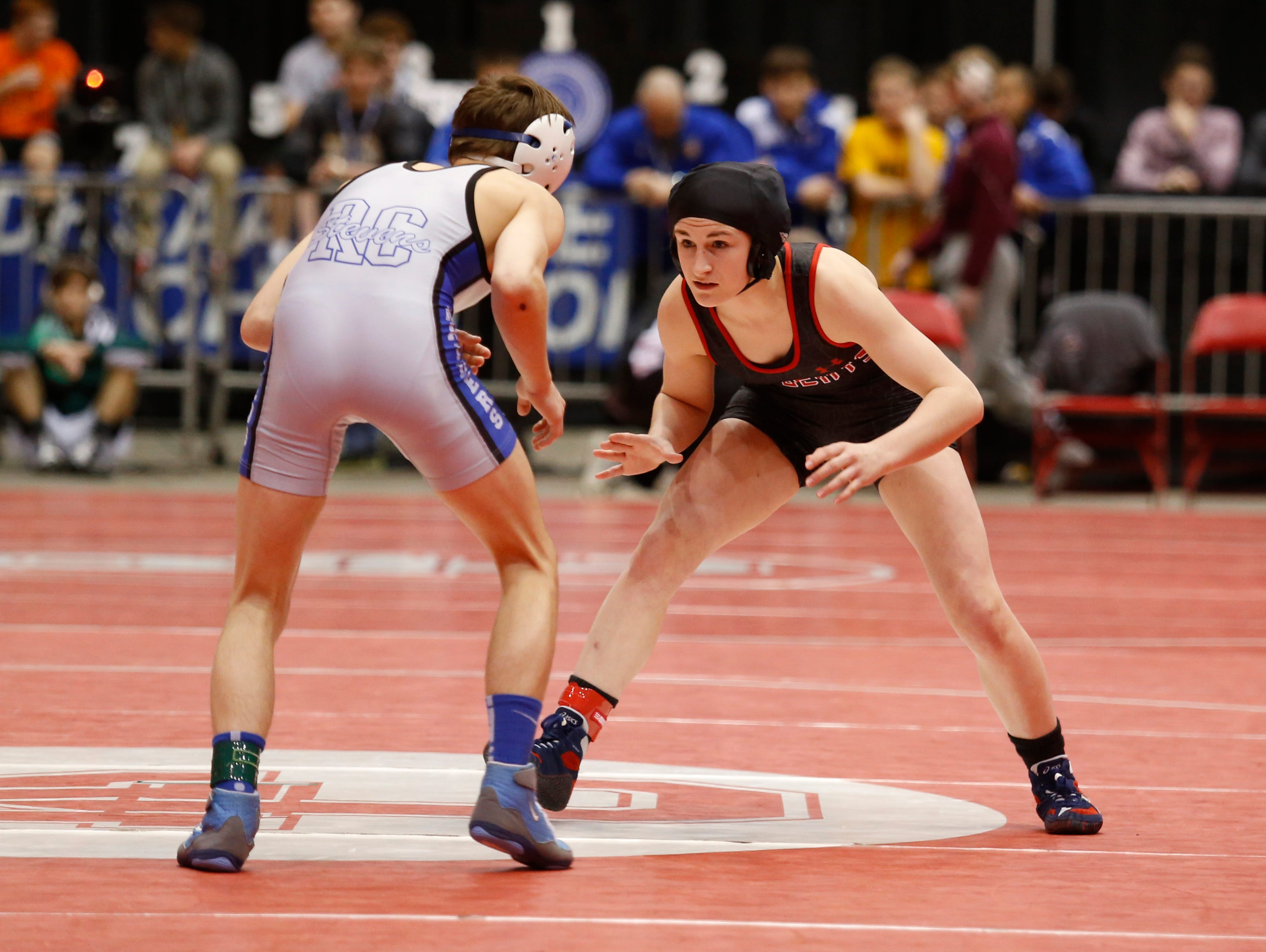 Brookings' Ronna Heaton, right, wrestles Rapid City Stevens' Cody BeVier, left, during the 113-pound third place match at the Class A state wrestling tournament Saturday in Rapid City. (Marcus Traxler/Mitchell Daily Republic)