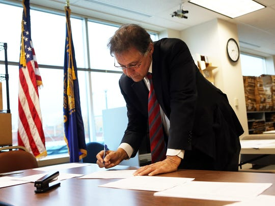 Marion County Clerk Bill Burgess certifies the results of the recent election.
