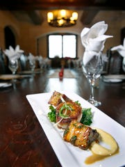 New York Wine & Culinary Center chef Andrea Chambers plated Bostrom Farms pork belly and pan seared Montauk scallop served with sautéed greens and sunchoke purée. The dish is  finished with a Allen Hill Farms apple cider molasses butter sauce.