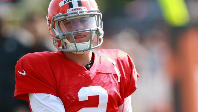 Browns QB Johnny Manziel spins one at training camp Thursday.