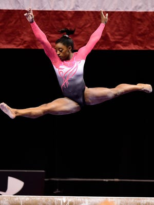 Simone Biles competes on beam during the P&G gymnastics championships at Bankers Life Fieldhouse.