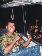 """-  -DC 3-28-97, 1C Muhammad Ali teases enthusiastic fans in Zaire in """"When We Were Kings."""" (Grammercy Pictures)"""