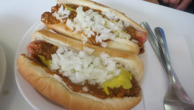 "The most common order at American Coney Island is two Coney dogs ""all the way"" with chili, onion and mustard."