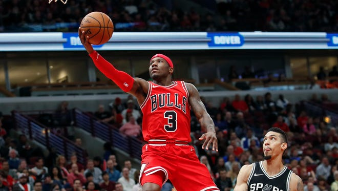 Chicago Bulls guard Kay Felder goes to the basket in front of San Antonio Spurs guard Danny Green during the first half Oct. 21, 2017 in Chicago.
