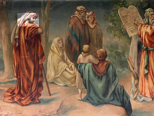 The mural of Moses receiving the Ten Commandments has darkened over time, but a recent test cleaning to one of the faces in the mural reveals bright colors.