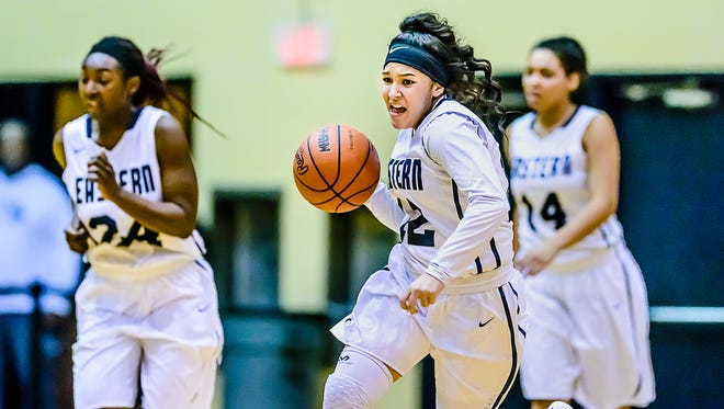 Nautiqa Garcia of Eastern leads a fast break during the Quakers' game with Jackson Tuesday January 10, 2017 in Lansing.  KEVIN W. FOWLER PHOTO