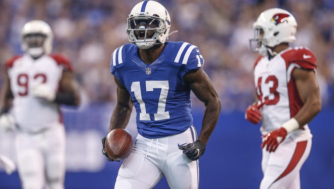 Indianapolis Colts wide receiver Kamar Aiken (17) celebrates after taking a pass from Colts quarterback Jacoby Brissett (7) down the field for a first down against the Arizona Cardinals at Lucas Oil Stadium on Sunday, Sept. 17, 2017.